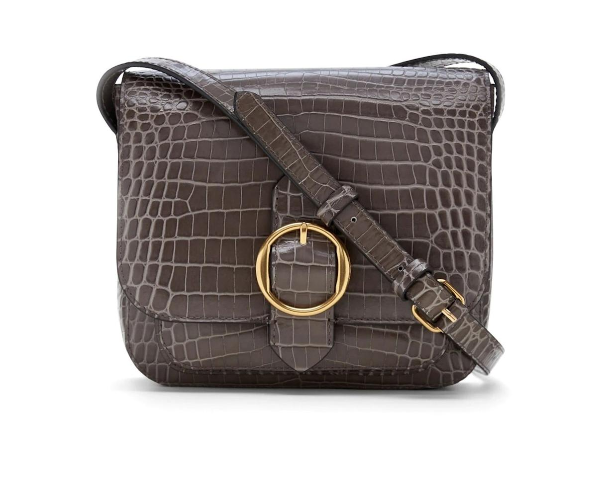<p>With its embossed moc-croc texture, this leather crossbody bag is stylish enough to wear to work or a night out.</p>