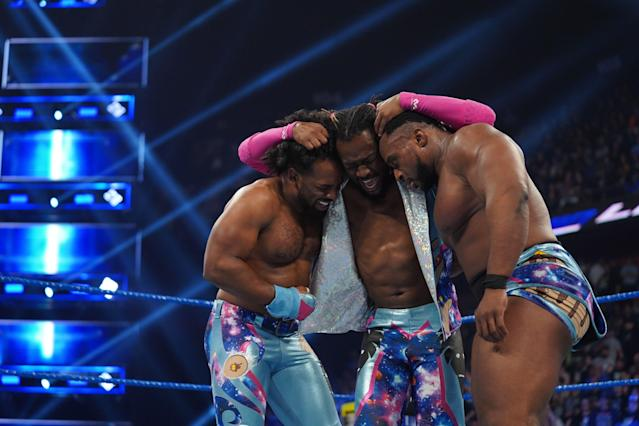 "WWE star Kofi Kingston celebrates with <a class=""link rapid-noclick-resp"" href=""/nfl/players/30304/"" data-ylk=""slk:Xavier Woods"">Xavier Woods</a> and Big E after a tag-team gauntlet match on ""Smackdown Live."" (Photo courtesy of WWE)"
