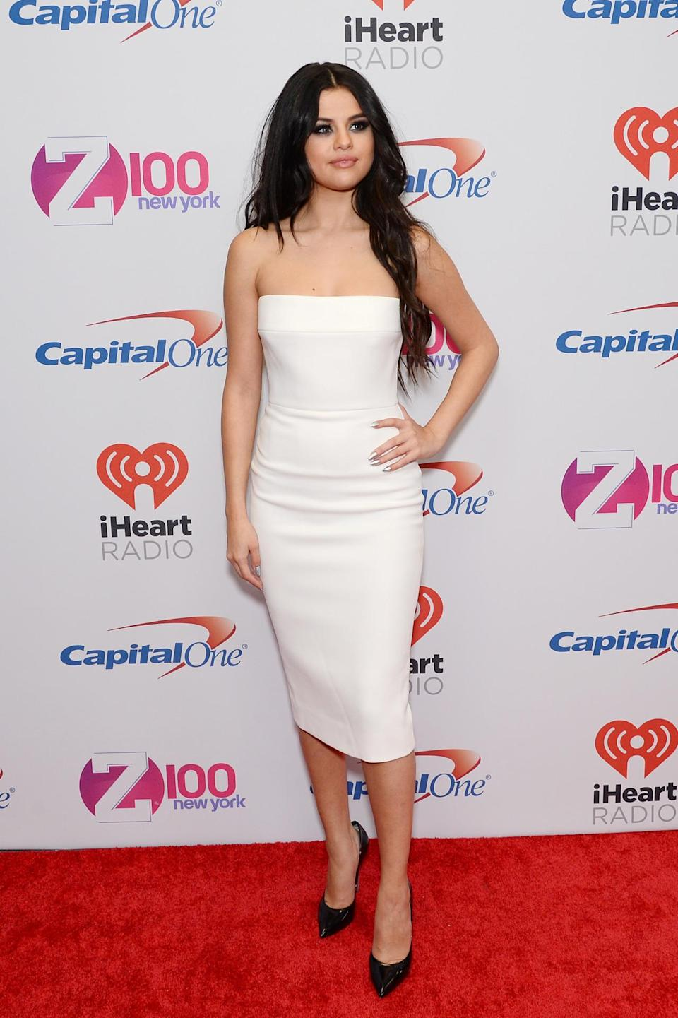 """<p>The """"Same Old Love"""" singer slipped into a white strapless bodycon dress and black pumps for her turn on the red carpet. </p>"""