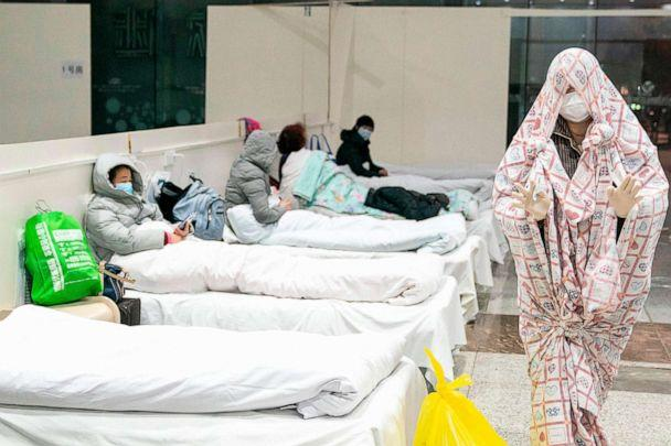 PHOTO: This photo taken on Feb. 5, 2020, shows a patients at an exhibition center that's been converted into a hospital as it starts accepting people displaying mild symptoms of the novel coronavirus in Wuhan in China's central Hubei province. (Str/AFP via Getty Images)