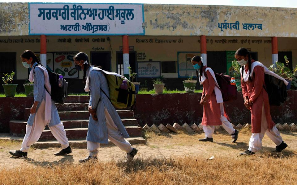 Students arrive at a government girls school after the educational institutions were reopened nearly six months after the spread of Covid-19 n Attari village near India-Pakistan Wagah border post. - AFP
