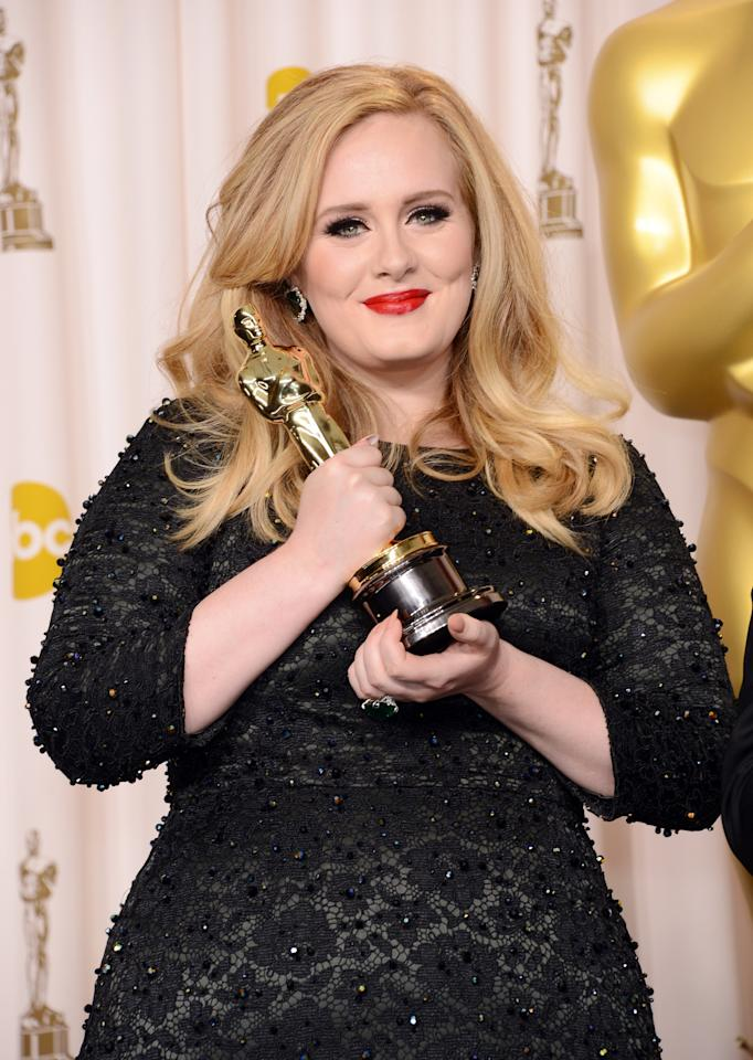 "HOLLYWOOD, CA - FEBRUARY 24:  Singer Adele, winner of the Best Original Song award for ""Skyfall,"" poses in the press room during the Oscars held at Loews Hollywood Hotel on February 24, 2013 in Hollywood, California.  (Photo by Jason Merritt/Getty Images)"