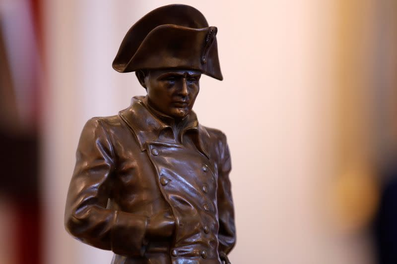 A bronze statue of Napoleon Bonaparte in frock coat is displayed at Osenat auction house in Fontainebleau