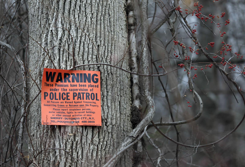 In this Feb. 1, 2018, photo, signs warning of police patrols dot the borders of Leather Hill Preserve in Wingdale, N.Y. A company tied to Donald Trump Jr. and Eric Trump owns the 171-acre hunting preserve that is being used as a private shooting range, where the sound of rifle fire from a wooden tower and exploding targets has riled nearby residents, neighbors told The Associated Press. (AP Photo/Seth Wenig)