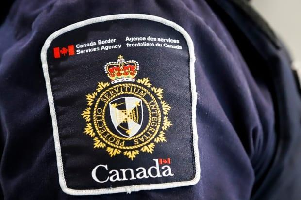 The Canada Border Services Agency (CBSA) says Ismail Nababteh of Calgary helped a foreign national illegally enter into Canada on July 13, 2017. It happened near Surrey, B.C.  (Jeff McIntosh/The Canadian Press - image credit)