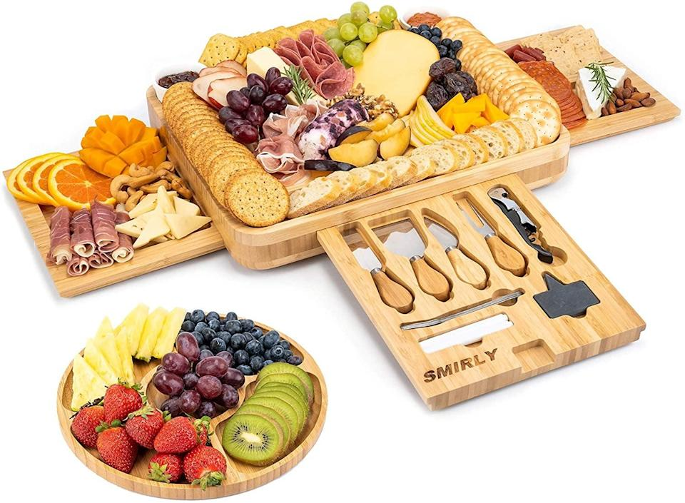 <p>Jump on the charcuterie-board bandwagon and get yourself the <span>Smirly Cheese Board and Knife Set: 16 x 13 x 2 Inch Wood Charcuterie Platter</span> ($70).</p>