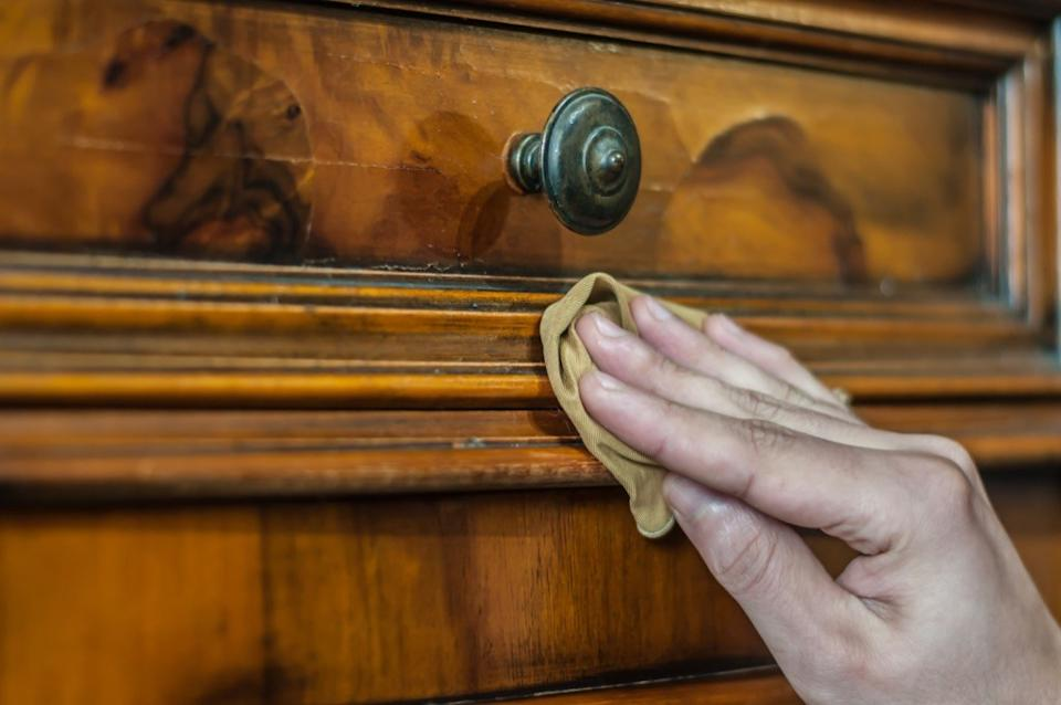 Woman cleaning furniture, hazardous thing in home