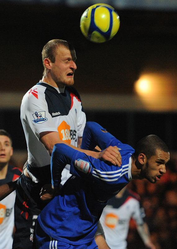 "Bolton Wanderers' English defender David Wheater (L) clears from Macclesfield Town's English midfielder Colin Daniel during the FA Cup football match between Macclesfield Town and Bolton Wanderers at Moss Rose, in Macclesfield, north-west England, on January 7 2012. (Photo by Andrew Yates. Restricted To Editorial Use. No Use With Unauthorized Audio, Video, Data, Fixture Lists, Club/league Logos Or ""live"" Services. Online In-match Use Limited To 45 Images, No Video Emulation. No Use In Betting, Games Or Single Club/league/player Publications. /AFP/Getty Images)"