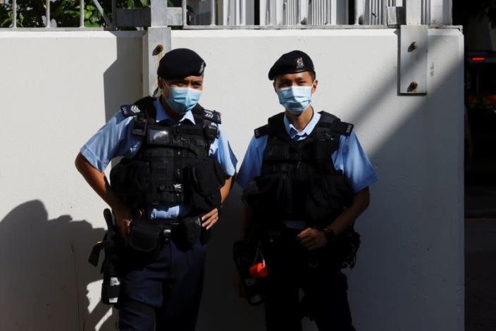 Police stand guard outside the West Kowloon Magistrates' Courts building in Hong Kong