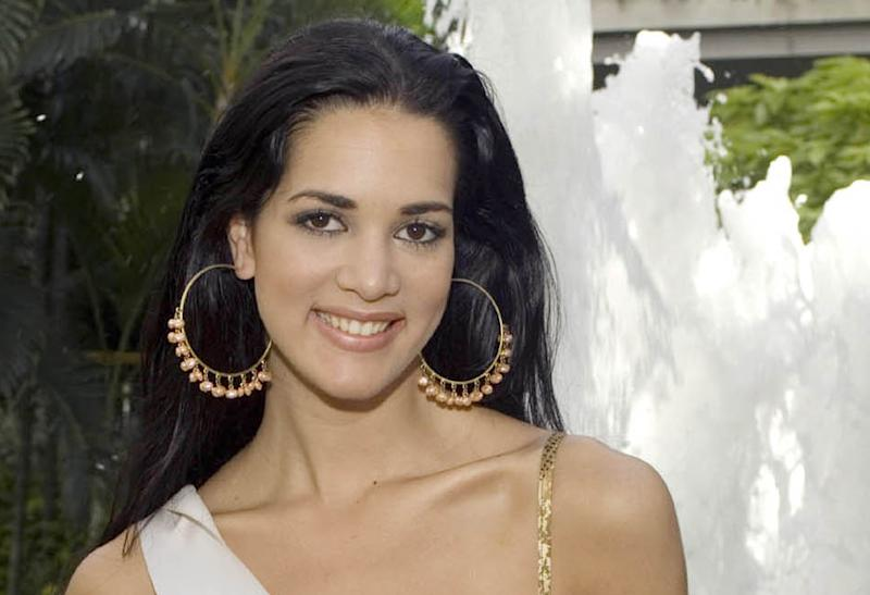 CORRECTS YEAR OF KILLING - FILE - This May 23, 2005 file photo released by Miss Universe shows Monica Spear, Miss Venezuela 2005, posing for a portrait ahead of the Miss Universe competition in Bangkok, Thailand. Venezuelan authorities say the soap-opera actress and former Miss Venezuela and her husband were shot and killed resisting a robbery after their car broke down. Prosecutors said in a statement that Monica Spear and Henry Thomas Berry were slain late Monday, Jan. 6, 2014 near Puerto Cabello, Venezuela's main port. (AP Photo/Miss Universe Darren Decker, File)