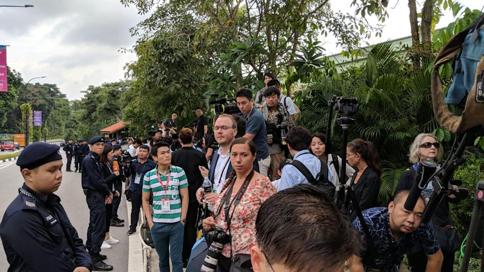 (A heated argument broke out between Ministry of Communications and Information officials and some of the assembled journalists outside Capella on 12 June, 2018. PHOTO: Wong Casandra/Yahoo News Singapore)