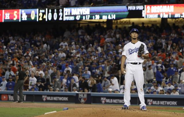 Los Angeles Dodgers' Yu Darvish reacts after giving up a two-run home run toHouston Astros' George Springer during the second inning of Game 7 of baseball's World Series Wednesday, Nov. 1, 2017, in Los Angeles. (AP Photo/Matt Slocum)