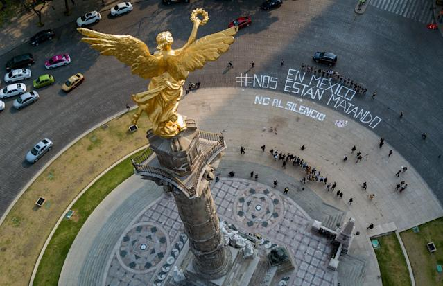 """<p>View of the Angel of Independence monument where a dozen reporters gathered to write, """"In Mexico they are killing us,"""" and """"No to silence"""", to call attention to the wave of journalist killings, in Mexico City, Tuesday, May 16, 2017. (Hector Vivas via Derecho a Informar via AP) </p>"""