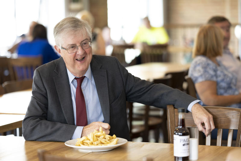 CWMBRAN, WALES - AUGUST 03: First Minister of Wales Mark Drakeford visits Page's fish and chip shop restaurant on August 3, 2020 in Cwmbran, Wales. Coronavirus lockdown measures continue to be eased as the number of excess deaths in Wales falls below the five-year average. From today up to 30 people can meet outdoors and pubs, restaurants and cafes can open to customers indoors. (Photo by Matthew Horwood/Getty Images)
