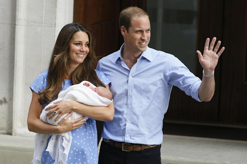 FILE - In this July 23, 2013 photo, Britain's Prince William, right, and Kate, Duchess of Cambridge, hold the Prince of Cambridge, as they pose for photographers outside St. Mary's Hospital exclusive Lindo Wing in London where the Duchess gave birth on July 22. (AP Photo/Kirsty Wigglesworth, File)