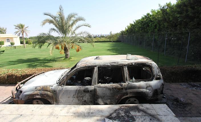 A burnt car in front of U.S. consulate, after an attack that killed four Americans, including Ambassador Chris Stevens on the night of Tuesday, in Benghazi, Libya, Thursday, Sept. 13, 2012. The American ambassador to Libya and three other Americans were killed when a mob of protesters and gunmen overwhelmed the U.S. Consulate in Benghazi, setting fire to it in outrage over a film that ridicules Islam's Prophet Muhammad. Ambassador Chris Stevens, 52, died as he and a group of embassy employees went to the consulate to try to evacuate staff as a crowd of hundreds attacked the consulate Tuesday evening, many of them firing machine-guns and rocket-propelled grenades. (AP Photo/Mohammad Hannon)