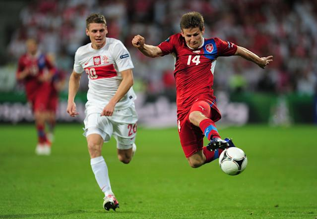 WROCLAW, POLAND - JUNE 16: Lukasz Piszczek of Poland chases down Vaclav Pilar of Czech Republic during the UEFA EURO 2012 group A match between Czech Republic and Poland at The Municipal Stadium on June 16, 2012 in Wroclaw, Poland. (Photo by Jamie McDonald/Getty Images)