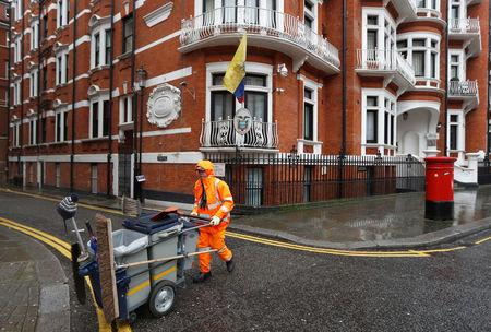 A street-cleaner walks past the Ecuadorian Embassy in London, Britain, February 13, 2018. REUTERS/Peter Nicholls
