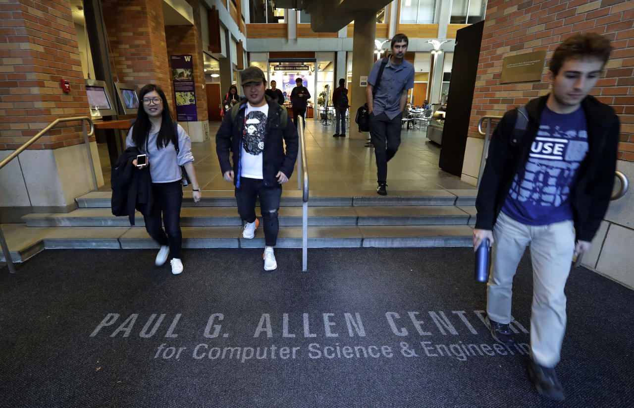 FILE- In this Oct. 15, 2018, file photo students walk out of the Paul G. Allen School of Computer Science & Engineering at the University of Washington in Seattle. Prior to his death on Monday, Allen invested large sums in technology ventures, research projects and philanthropies, some of them eclectic and highly speculative. Outside of bland assurances from his investment company, no one seems quite sure what happens now. (AP Photo/Elaine Thompson, File)