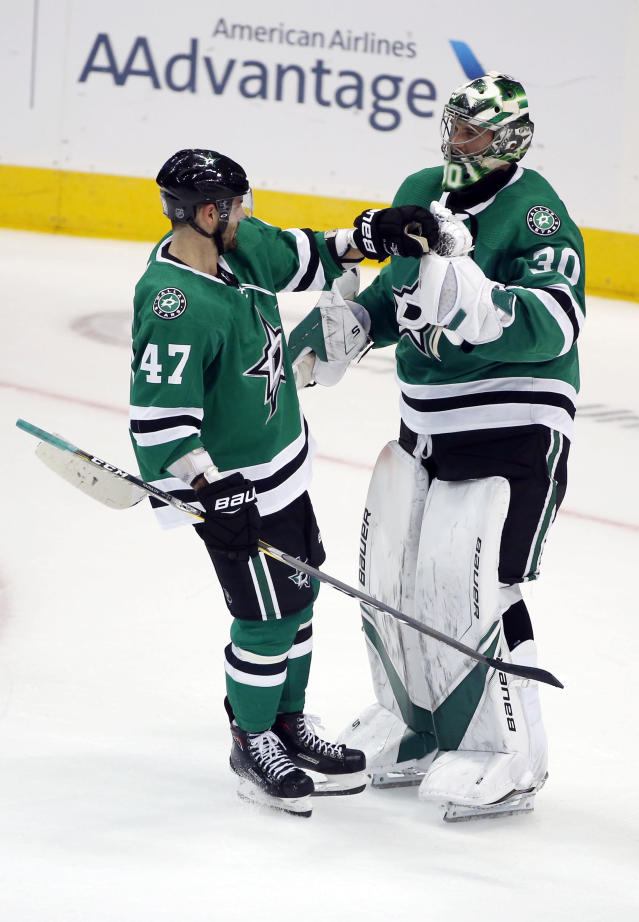 Dallas Stars right wing Alexander Radulov (47) congratulates goaltender Ben Bishop (30) after the team's 3-0 win against the Arizona Coyotes during an NHL hockey game in Dallas, Thursday, Oct. 4, 2018. (AP Photo/Michael Ainsworth)