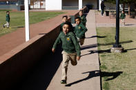 Children run during recess at the St. Agnes Elementary School in Phoenix, Ariz., on March 3, 2020. In 2016, the student body at St. Agnes was two-thirds Hispanic; the figure is now 95%, and virtually every student receives financial aid through state-approved tax credit programs that extend to private schools. (AP Photo/Dario Lopez-MIlls)