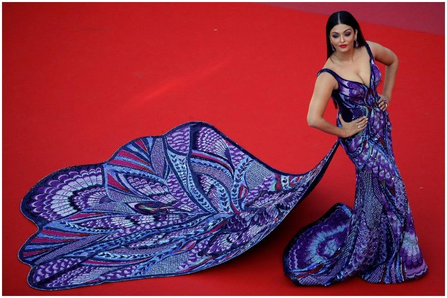 Aishwarya, who clocks her 17th year at the film jamboree this time as L'Oreal Paris brand ambassador, took a confident walk with an exquisite three-meter train trailing behind and ensured all eyes were on her. (Image: Reuters)