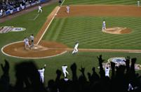 """<p><strong>October 16, 2003</strong>: Aaron Boone didn't start Game 7 of the 2003 American League Championship Series—but he ended it. Inserted as a pinch runner in the eighth inning of a tie game, Boone led off the bottom of the 11th inning against Boston knuckleballer Tim Wakefield. Mired in a deep slump (2-for-16 in the series so far), Boone debated whether to take the first pitch, to get a look at Wakefield's jittery stuff before taking a swing at it. Wakefield did indeed start Boone with a knuckler…and Boone swung. Play-by-play man Charlie Steiner calls it like this:<br><br><em>There's a fly ball, deep to left! It's on its way! There it goes! And the Yankees are going to the World Series!</em><br><br>Kevin Millar was a member of that '03 Sox team and he remembers the moment well, if not fondly. """"Walking off the field in 2003 with that feeling in your stomach, it doesn't get worse than that,"""" says Millar, now an MLB analyst. """"But this is history.""""<br><br>History indeed. The homer is so big that it takes a place among the biggest in the Yankees' storied history, right up with those by Chris Chambliss (1976 ALCS) and Reggie Jackson (1978 WS). It even has its own Facebook page.<br> </p>"""