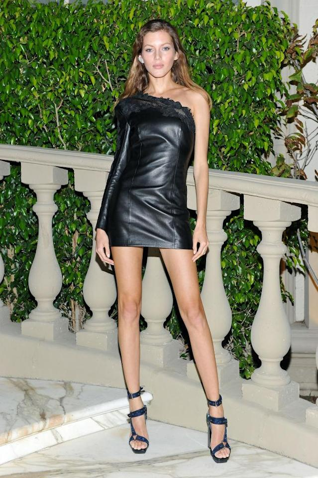 <p>The leggy model wore a one-shoulder leather mini dress. (Photo by Donato Sardella/Getty Images for BALMAIN) </p>