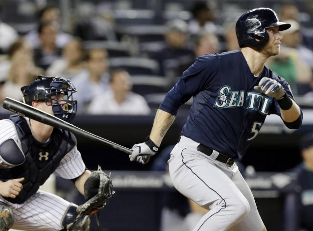 Seattle Mariners' Michael Saunders follows through on a ground-rule double to drive in a run during the fourth inning of a baseball game against the New York Yankees, Thursday, May 1, 2014, in New York. (AP Photo/Frank Franklin II)
