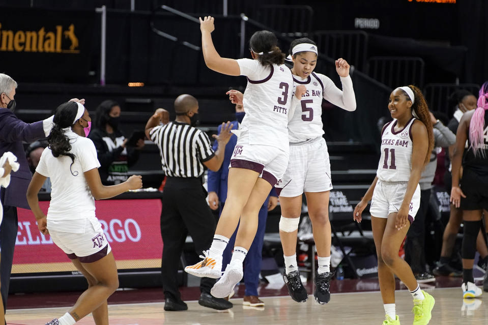 Texas A&M guard Jordan Nixon (5) reacts with teammate Destiny Pitts (3) after a timeout against South Carolina during the second half of an NCAA college basketball game Sunday, Feb. 28, 2021, in College Station, Texas. (AP Photo/Sam Craft)