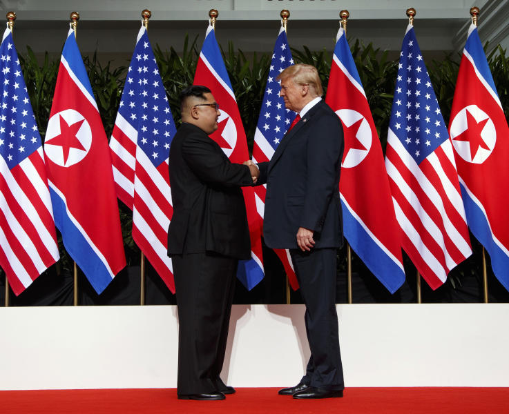 FILE - In this June 12, 2018, file photo, North Korean leader Kim Jong Un, left, and U.S. President Donald Trump shake hands prior to their meeting on Sentosa Island in Singapore. The North's Korean Central News Agency said Thursday, Jan. 24, 2019 that Kim received a letter from Trump from a North Korean envoy who travelled to Washington and met Trump last week. North Korea says Kim has ordered preparations for a second summit with Trump. (AP Photo/Evan Vucci, File)