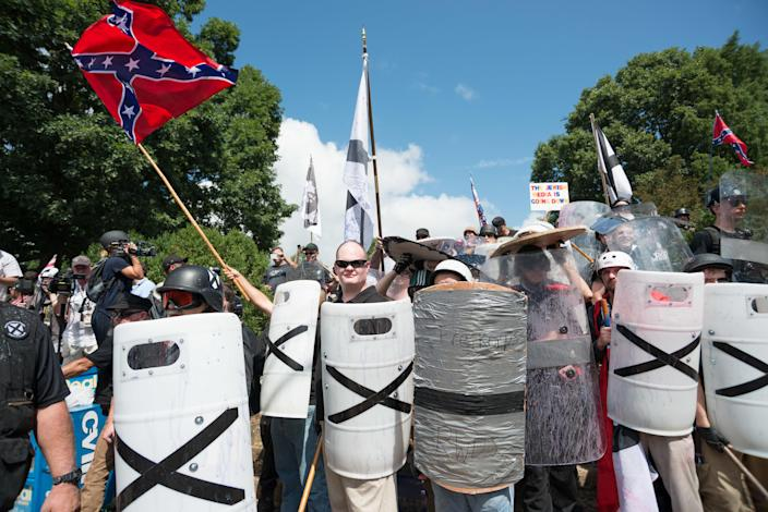 """Neo-Nazis, white supremacists and other """"alt-right"""" factions scuffled with counter-demonstrators near Emancipation Park (formerly Lee Park) in downtown Charlottesville, Va. (Photo: Albin Lohr-Jones/Pacific Press/LightRocket via Getty Images)"""