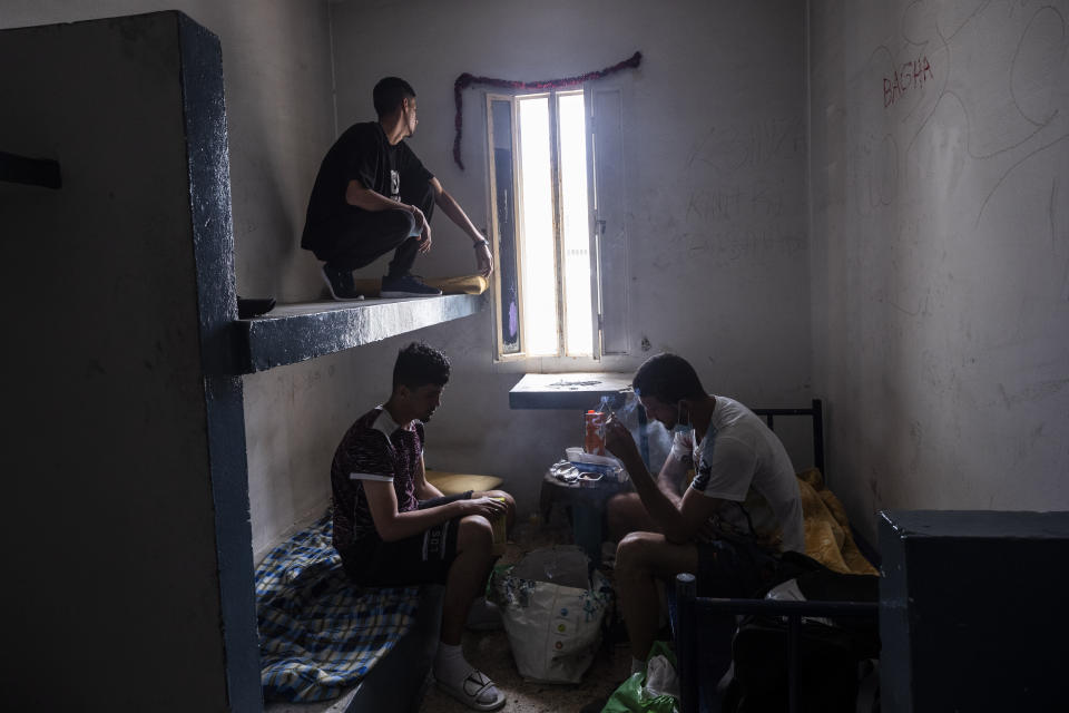 Migrants take shelter inside an abandoned building in the Spanish enclave of Ceuta, Friday, May 21, 2021. (AP Photo/Bernat Armangue)