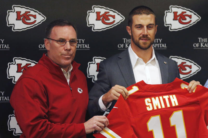 Former Kansas City Chiefs general manager John Dorsey, left, stands with quarterback Alex Smith in 2013. (AP)