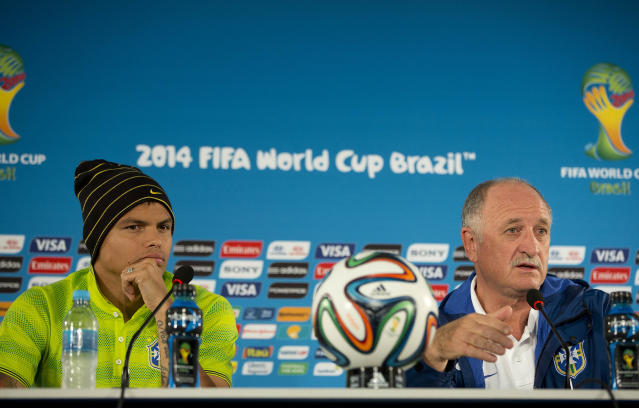 Brazil's coach Luiz Felipe Scolari, right, and player Thiago Silva attend a press conference one day before their team's World Cup third-place soccer match against the Netherlands at the Estadio Nacional in Brasilia, Brazil, Friday, July 11, 2014. (AP Photo/Andre Penner)