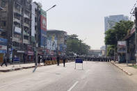 In this image from video, a row of riot police blocks a road to prevent protesters from marching forward in Yangon, Myanmar Saturday, Feb. 6, 2021. The military authorities in charge of Myanmar broadened a ban on social media following this week's coup, shutting access to Twitter and Instagram, while street protests continued to expand Saturday as people gathered again to show their opposition to the army takeover. (AP Photo)