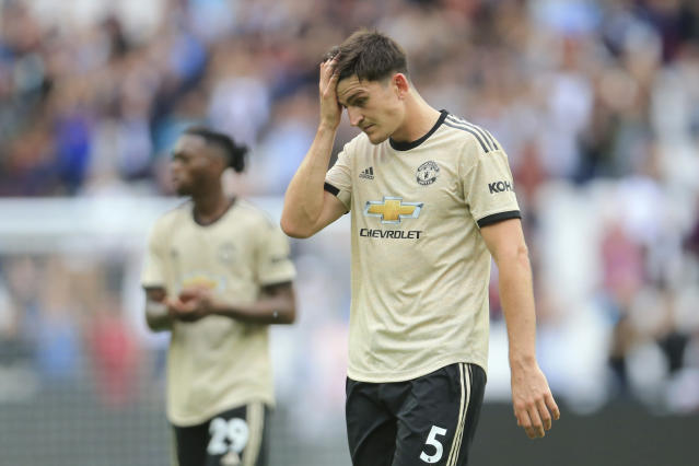 Manchester United's Harry Maguire touches his forehead as he leaves at the end of the English Premier League soccer match between West Ham and Manchester United at London stadium in London, Sunday, Sept. 22, 2019. West Ham beat Manchester United 2-0. (AP Photo/Leila Coker)