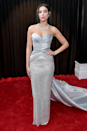 """<p>The <a href=""""https://www.cosmopolitan.com/uk/fashion/celebrity/g26276421/grammys-2019-red-carpet/"""" rel=""""nofollow noopener"""" target=""""_blank"""" data-ylk=""""slk:2019 Grammys red carpet"""" class=""""link rapid-noclick-resp"""">2019 Grammys red carpet</a> was that bit sparklier with Dua sporting this strapless silver shimmery Versace dress.</p>"""