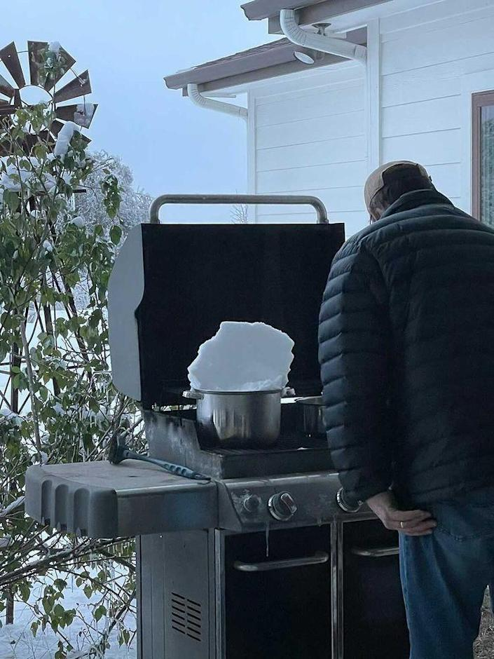 Crawford's family using their grill to melt ice