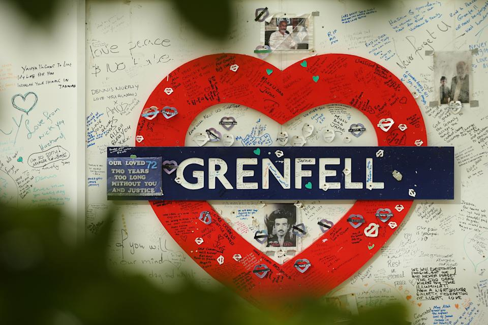 TOPSHOT - Messages of support are written on a wall surrounding Grenfell tower in west London on October 30, 2019. - The emergency response to a 2017 high-rise fire that killed 71 people in London had