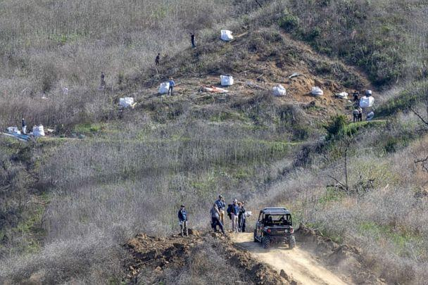 PHOTO: Investigators work at the scene of the helicopter crash, where former NBA star Kobe Bryant and his 13-year-old daughter Gianna died, Jan. 28, 2020, in Calabasas, Calif. (David Mcnew/Getty Images, FILE)