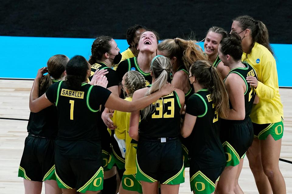 Oregon forward Sedona Prince, center, celebrates with teammates after a victory over Georgia in the second round of the NCAA Tournament.