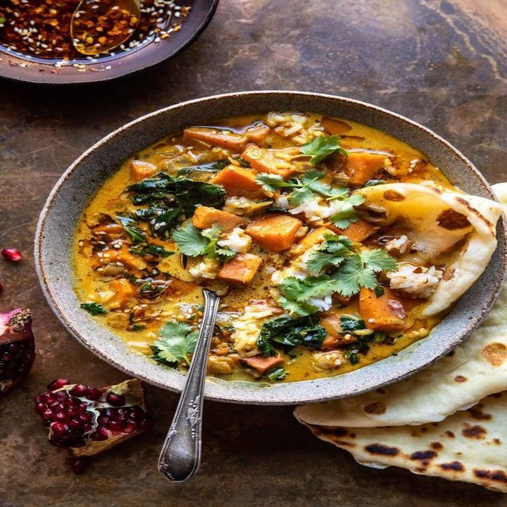 Sweet potato and rice stew with naan for dipping.
