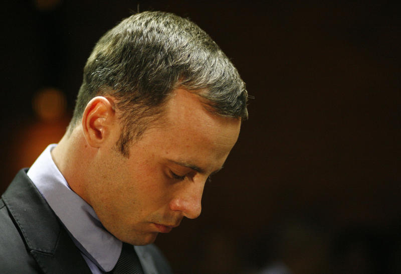 FILE - In this Feb. 21, 2013 file photo, Olympic athlete Oscar Pistorius stands during his bail hearing at the magistrate court in Pretoria, South Africa A judge in South Africa says Pistorius, who is charged with murdering his girlfriend, can leave South Africa to compete in international competition, with conditions. (AP Photo/Themba Hadebe, File)