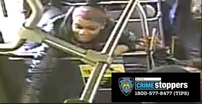 The unidentified female shown here struck the victim with an umbrella, according to police. The NYPD has asked anyone with information regarding the suspect's identity to call 1-800-577-TIPS (8477). (NYPD)