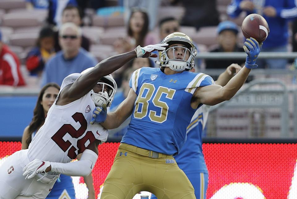 UCLA's Greg Dulcich attempts to make a one-handed catch as Stanford cornerback Kendall Williamson defends.