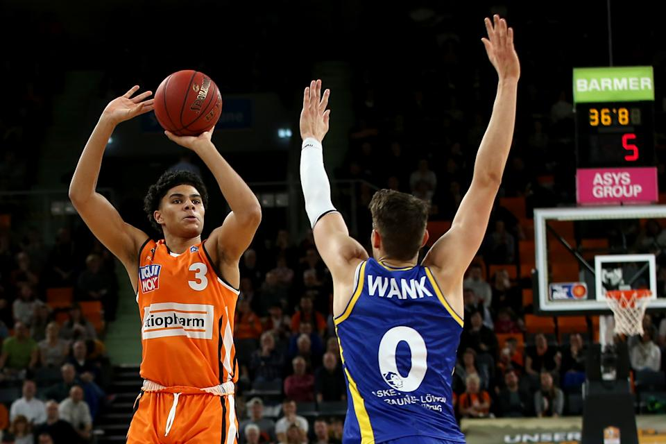 Killian Hayes of Ulm and Lukas Wank of Braunschweig battle for the ball during the EasyCredit Basketball Bundesliga (BBL) match between Ratiopharm Ulm and Basketball Loewen Braunschweig at ratiopharm Arena on February 14, 2020 in Ulm, Germany.