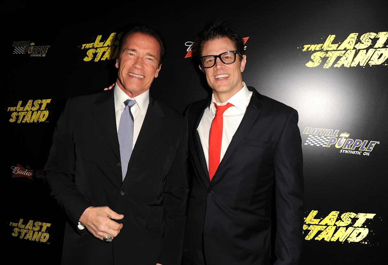 "HOLLYWOOD, CA - JANUARY 14:  Actors Arnold Schwarzenegger (L) and Johnny Knoxville arrive at the premiere of Lionsgate Films' ""The Last Stand"" at Grauman's Chinese Theatre on January 14, 2013 in Hollywood, California.  (Photo by Kevin Winter/Getty Images)"