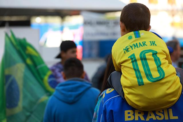 Soccer Football - World Cup - Group E - Serbia vs Brazil - Porto Alegre, Brazil - June 27, 2018 - A boy wears Neymar's jersey as he watches the broadcast. REUTERS/Diego Vara