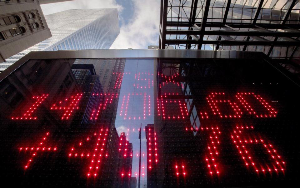 """<span class=""""caption"""">A sign board in Toronto's financial district shows the Toronto Stock Exchange's market value and gain. </span> <span class=""""attribution""""><span class=""""source""""> THE CANADIAN PRESS/Frank Gunn</span></span>"""